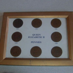 1953- 1967  United Kingdom One Penny pieces mounted in frame